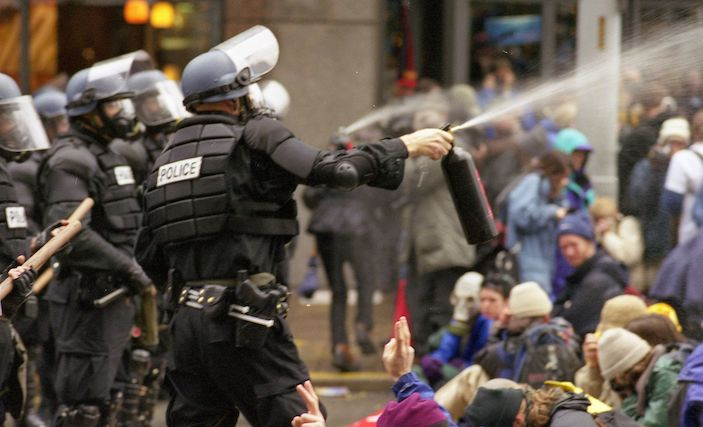 Outrage at video showing child who was maced by police at Seattle protest (The Guardian)